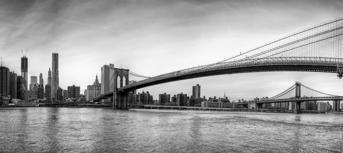 Manhattan skyline with brooklyn bridge foreground and manhattan bridge background new york u s